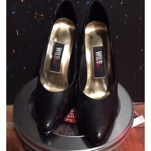 Black high heels with black and gold colored heel